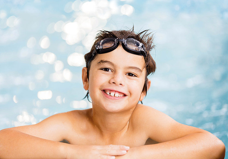 child wearing goggles, kids swimming lessons