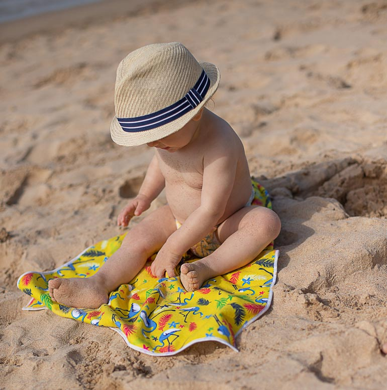 child at beach wearing babylove swim pants