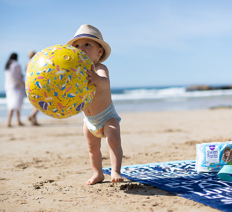 New babyLove swim pants, child at beach