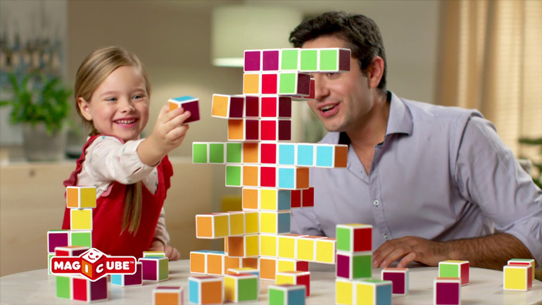 dad and daughter playing Magicube