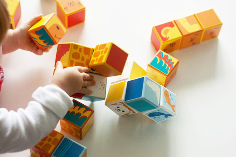 child playing with magicube, construction cubes