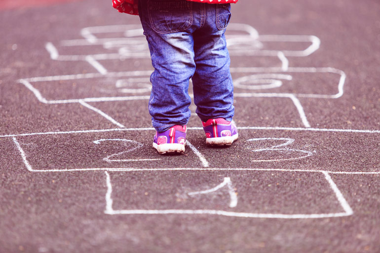 kid playing hopscotch driveway accidents