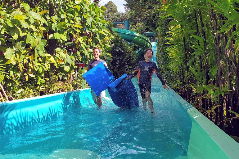 Duelling racer waterslide Adventue Cove Singapore Sentosa with kids