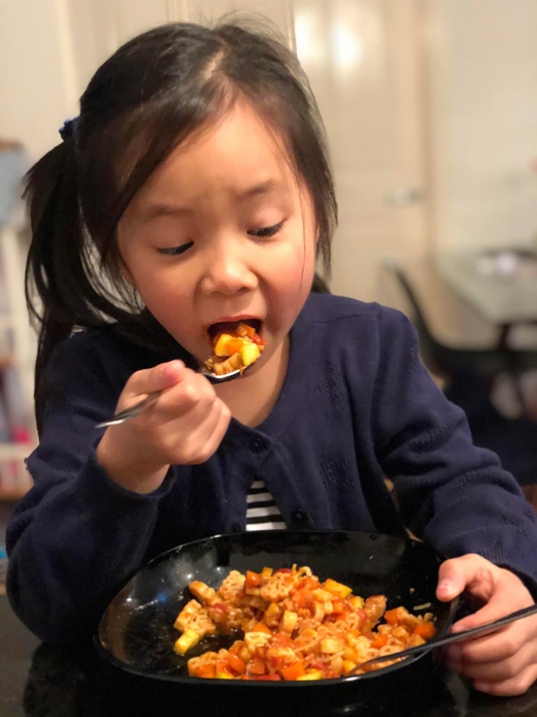 child eating Vetta pasta