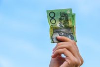 hand holding Australian currency