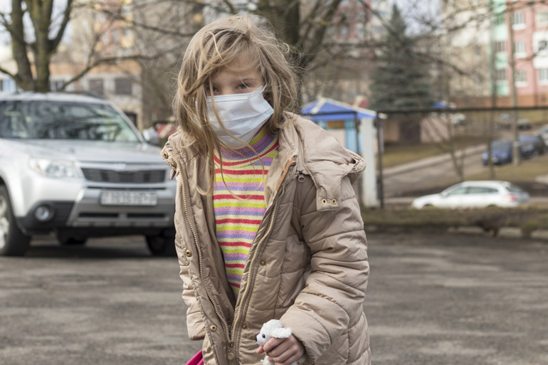 Girl with face mask - coronavirus