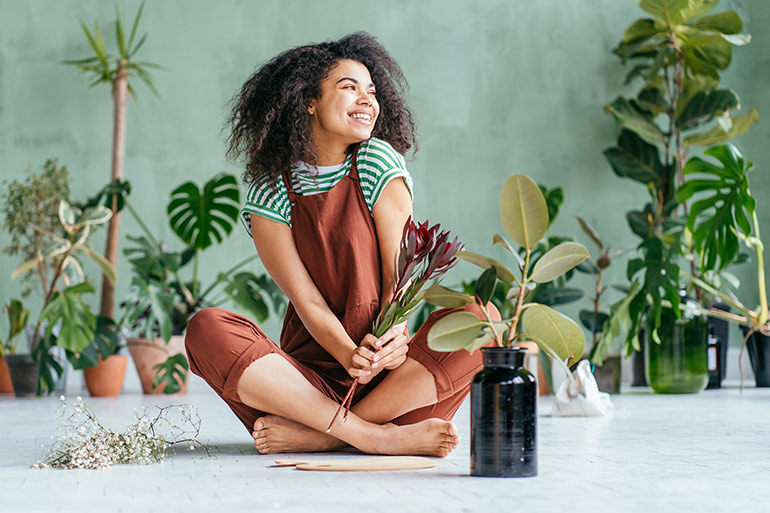 lady surrounded by indoor plants