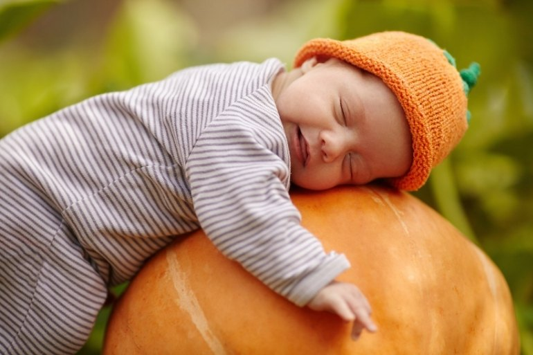 October baby with a pumpkin