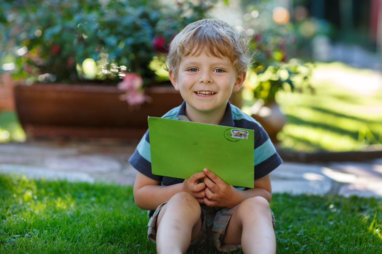 child with letter for pandemic penpal