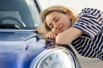 woman in love with her new car